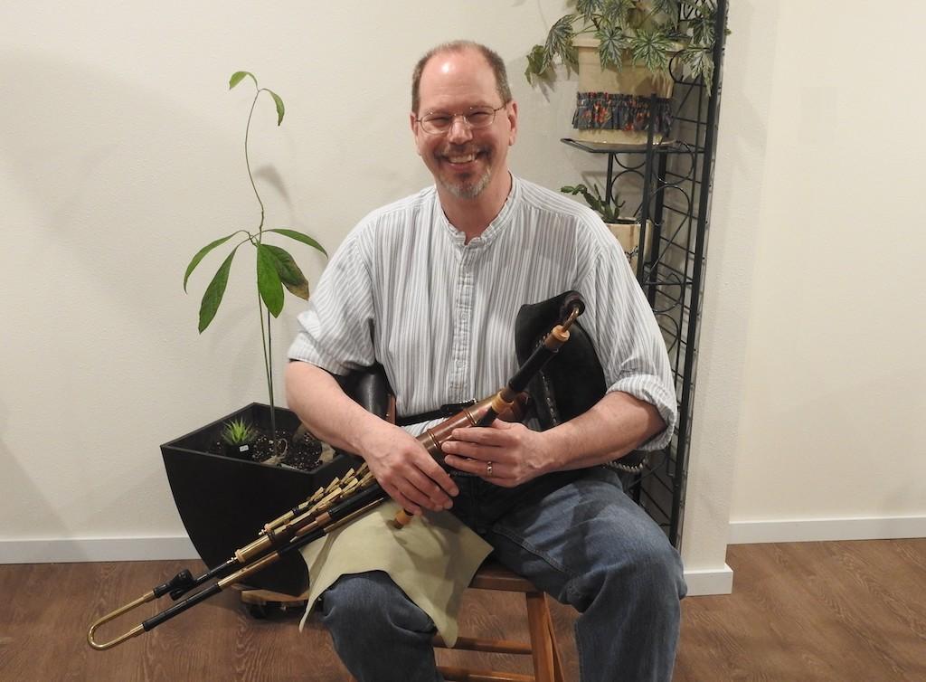 John Ingman with a traditional Irish instrument